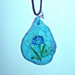 blue flower on turquoise made from paper mache clay